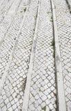 Plancher en pierre typique de Lisbonne Photographie stock libre de droits