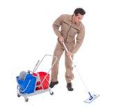 Plancher masculin de nettoyage de balayeuse Images libres de droits