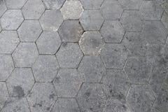 Plancher/trottoir hexagonaux gris de brique dans la vue supérieure backg de modèle Photo libre de droits