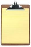 Planchette avec le papier à lettres jaune Images stock