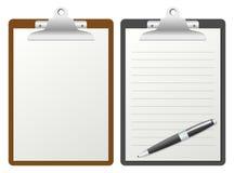 Planchette avec le papier blanc Photos libres de droits