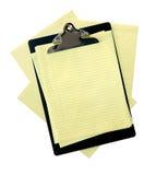 Planchette avec le papier jaune image stock