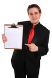 Planchette de fixation d'homme avec la page blanc Images stock