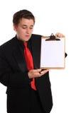 Planchette de fixation d'homme avec la page blanc Photos stock