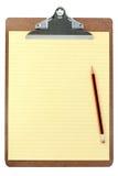 Planchette et papier jaune Photographie stock libre de droits