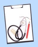 Planchette et stéthoscope photo stock