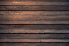 Plancia di legno di marrone scuro della casa di vecchia tradizione fotografia stock libera da diritti