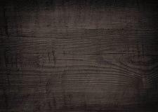 Plancia, ripiano del tavolo, superficie del pavimento o spezzettamento di legno nera, tagliere Fotografia Stock Libera da Diritti
