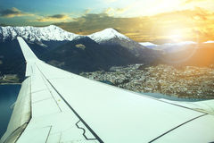 Pland flying over queenstown impotant town and traveling destina Stock Image