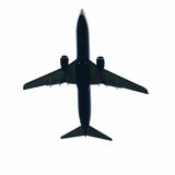 Plane. Airline plane in silhouette just after take off royalty free stock photography