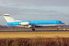 Plane. A blue aircraft rolling towards the runway for take off Stock Images