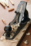 Plane. Jack plane on carpenter's table with chips scattered around Stock Photos