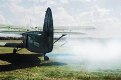 The plane An-2 goes to flight with parachutists Stock Image