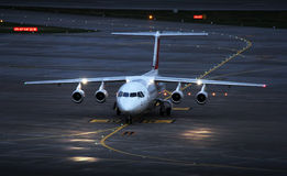 Plane. Landing plane on the airport in the afternoon Royalty Free Stock Photos