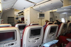 In the plane. Modern plane seats with built-in screens, Qatar airlines, 20.07.2011 Stock Photography