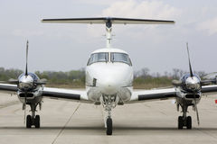 Plane. Private business airplane parked on runway stock image