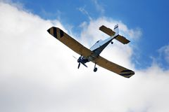 Plane. Yellow and blue plane on the blue sky Royalty Free Stock Photos