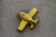 Plane. Figure of Yellow Plane on the wall stock image