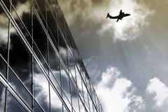Plane. Over building royalty free stock photos