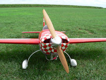 Plane. Red remote control airplane in grassy field Royalty Free Stock Photos