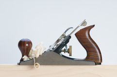 Plane. A hand plane and wood shavings Royalty Free Stock Photography