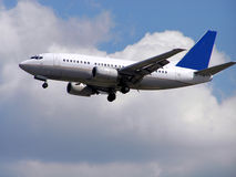 Plane. A Boeing 737 airplane approaching the airport Stock Photos