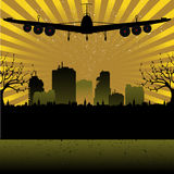 Plane above the city Royalty Free Stock Images