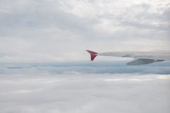 Plane above clouds Stock Photography