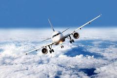 Plane above the clouds Royalty Free Stock Images