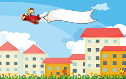 A plane above the houses with an empty banner Stock Photography