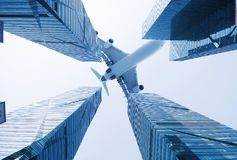 Plane  above the modern city Stock Image