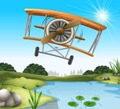 A plane above the pond Stock Photo