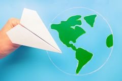 Plane above world map. Travel and tourism concept royalty free stock images