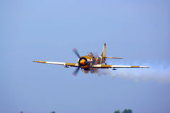 Plane in action at aero show Stock Photos