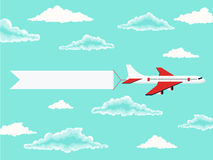 Plane and advertising banner in the cloudy sky Royalty Free Stock Photos