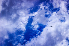 Plane against partly cloudy sky Stock Images