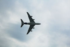 The plane in the air. The aircraft in the airspace Royalty Free Stock Photo
