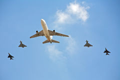 Plane, Air show. Plane in precision flight formation against a blue sky Royalty Free Stock Image