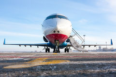 Plane on airfield. Jet plane on winter airfield royalty free stock photo
