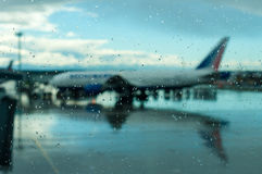 Plane at the airport. Bad weather, hurricane Royalty Free Stock Image