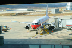 Plane at the airport. Red plane at the Chinese airport stock image