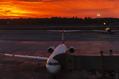 Plane at the airport during sunset Royalty Free Stock Photography