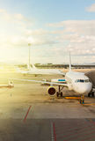 Plane at airport. White plane at airport waiting for departure Royalty Free Stock Photos