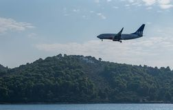 Plane Approach to land. Commercial jet approaching to land in Skiathos island Greece, September 2018 royalty free stock image