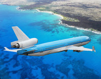 Plane approaching coastline Stock Photo