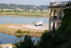Plane arrives at the airport in Kerkyra, Corfu Island, Greece.  Royalty Free Stock Photos