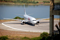 Plane arrives at the airport in Kerkyra, Corfu Island, Greece.  Royalty Free Stock Photo