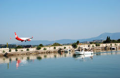 Plane arrives at the airport. In Kerkyra, Corfu Island, Greece Royalty Free Stock Images