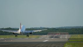 The plane arrives at the airport. Rear view of twin engine unrecognizable airplane arrives at the airport stock footage