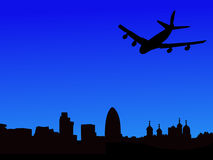 Plane arriving in London. Four engine plane flying towards London skyline Stock Photography